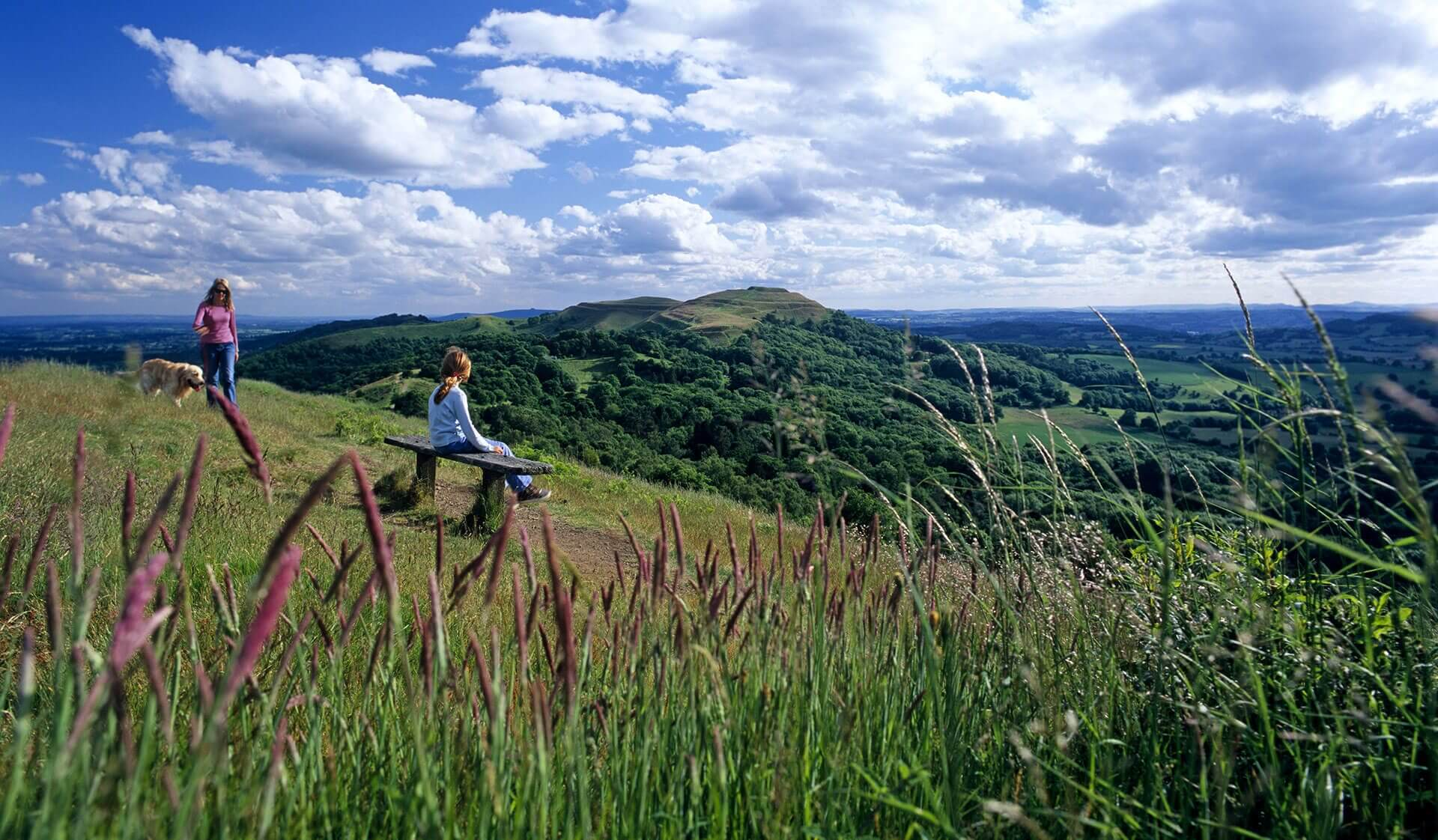 Girl sitting on a bench on the Malvern Hills